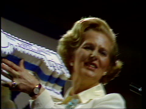 tory party conference thatcher receives birthday cake and bear england brighton ms margaret thatcher conservative party leader holds up birthday cake... - international landmark stock videos & royalty-free footage