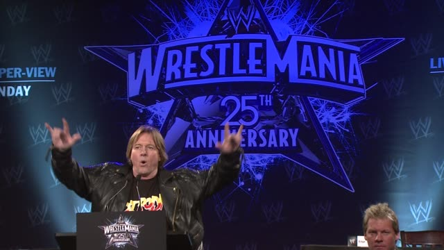 toss grisham introduces 'rowdy' roddy piper at the wrestlemania 25th anniversary press conference at new york ny - play fight stock videos and b-roll footage