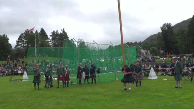 MS Tossing Caber at braemar royal highland games / Braemar, Aberdeenshire, Scotland