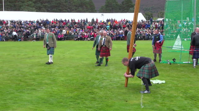 ms ts tossing caber at braemar royal highland games / braemar, aberdeenshire, scotland - highland games stock videos & royalty-free footage