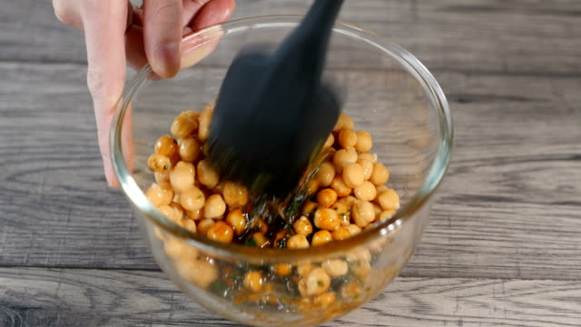 tossing chickpea with paprika and parsley dressing - legume family stock videos and b-roll footage
