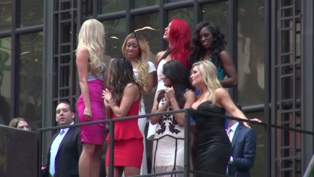 'total divas' cast pose for wwe wrestlemania near the marquee of the hard rock cafe on april 01, 2014 in new york city. - cast member stock videos & royalty-free footage