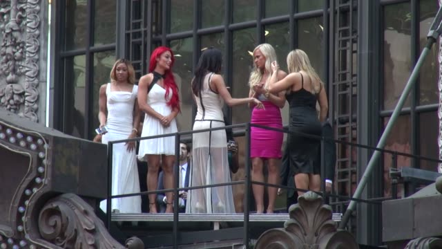 'Total Divas' cast pose for WWE Wrestlemania near the marquee of the Hard Rock Cafe on April 01 2014 in New York City