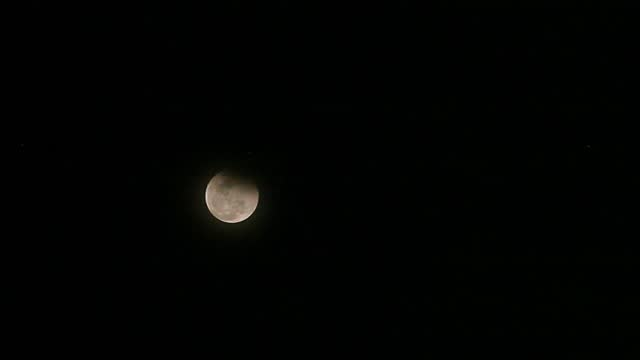 total lunar eclipse moving in the sky as seen from the faculty of astronomy at the muhammadiah university of north sumatra on may 26, 2021 in medan,... - albert damanik stock videos & royalty-free footage