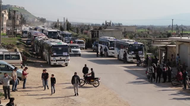 total of 1,055 civilians reached idlib on march 13, 2018 after being evacuated from the capital's al-qadam district, according to anadolu agency... - civilian stock videos & royalty-free footage