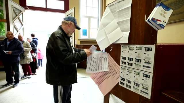 a total of 21 countries of the european union hit the ballot boxes to vote for the european parliament elections on sunday the voting process is... - 投票点の映像素材/bロール