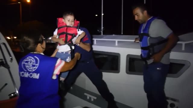 a total of 30 migrants of afghan congolese guinean and cameroonian origin who were trying to reach greece illegally have been caught by turkish coast... - immigrant bildbanksvideor och videomaterial från bakom kulisserna