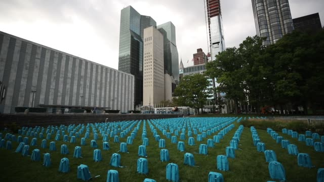 total of 3758 school backpacks representing one for each child died in a conflict last year created by unicef laid out on the lawn of un headquarters... - unicef stock videos & royalty-free footage