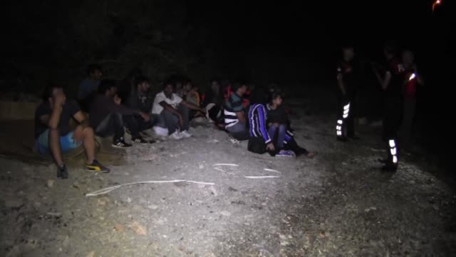 vídeos de stock e filmes b-roll de total of 42 are captured by turkish coast guard while they were illegally trying to reach kos island in shores of southwestern city of mugla turkey... - crise de migrantes europeia 2015 2016