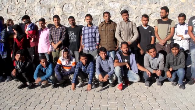 total of 59 irregular migrants of afghan and bangladeshi origin, including 14 women and 11 children, who had entered turkey illegally were held... - indischer subkontinent abstammung stock-videos und b-roll-filmmaterial