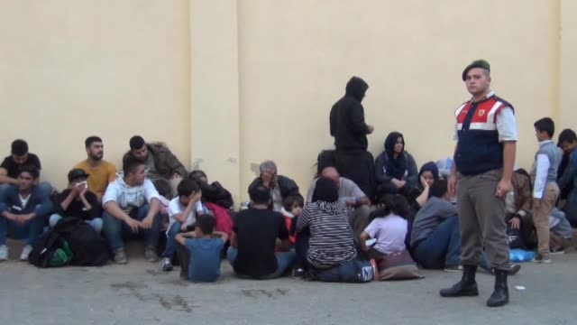 vídeos de stock e filmes b-roll de a total of 59 refugees and migrants of georgian and syrian origin who were trying to reach greece's rhodes island illegally have been caught by... - crise de migrantes europeia 2015 2016