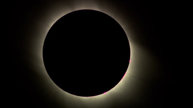 MS, Total solar eclipse against dark sky