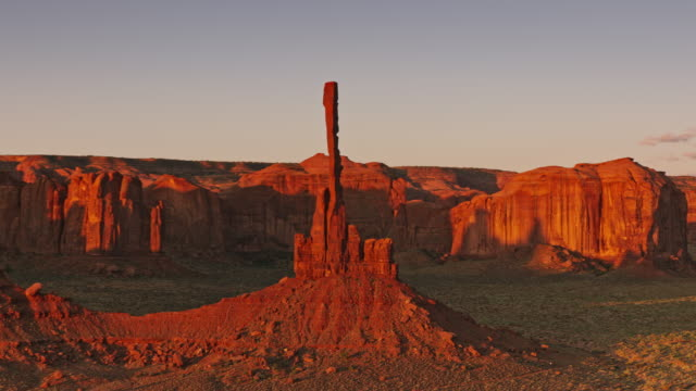aerial totem pole pillar in monument valley national park in early morning sun - monument valley stock videos & royalty-free footage