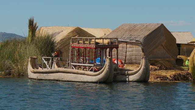 totora reed boats at uros island, lake titicaca - anchored stock videos & royalty-free footage