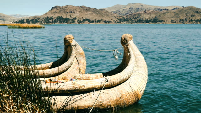 totora reed boats in titicaca lake, puno, peru - pre columbian stock videos & royalty-free footage