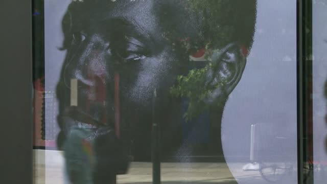 tottenham artist has black lives matter works exhibited on oxford street; england: london: oxford street: ext kelvin okafor interview sot. cutaways... - interview raw footage stock videos & royalty-free footage
