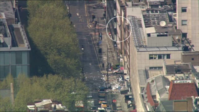 tottenham court road closed during siege: man arrested; air view / aerial of siege scene as object flies out of window to ground below - tottenham court road stock videos & royalty-free footage