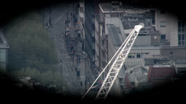 tottenham court road closed during siege: man arrested; graphicised air view of equipment being thrown out of fifth floor window during siege - tottenham court road stock videos & royalty-free footage