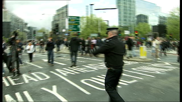 tottenham court road closed during siege: man arrested; police officer holding police tape cordon and telling people to move on sot police officer... - tottenham court road stock videos & royalty-free footage