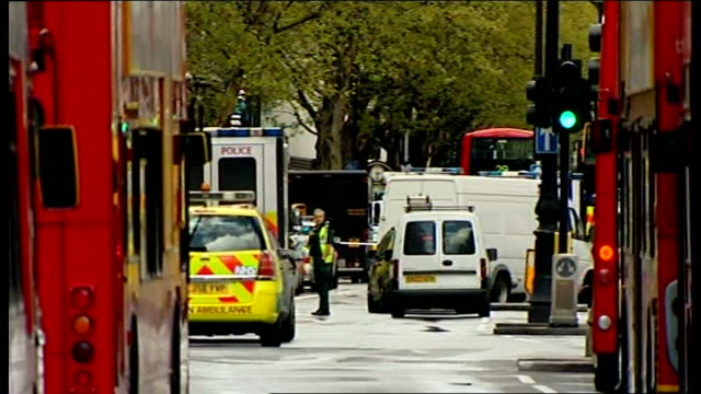 tottenham court road closed during siege: man arrested; police van drives away - tottenham court road stock videos & royalty-free footage