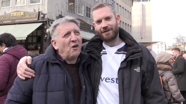 tottenham fans give their view on the upcoming champions league clash with borussia dortmund at the signal iduna park stadium - borussia dortmund stock videos and b-roll footage