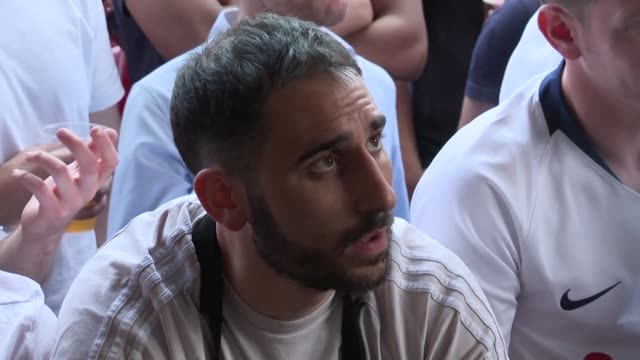tottenham hotspur fans in london react with disappointment as their team loses 20 to liverpool in the champions league final - liverpool england stock-videos und b-roll-filmmaterial