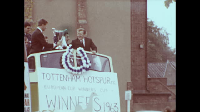 tottenham hotspur fc tour bus victory parade through tottenham london winners of the european cup winners cup 1963 against atletico madrid | long... - cup stock videos & royalty-free footage