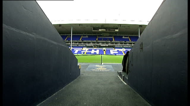 tottenham hotspur found liable for player's brain damage point of view along from tunnel towards pitch traffic along past stadium - brain damage stock videos & royalty-free footage