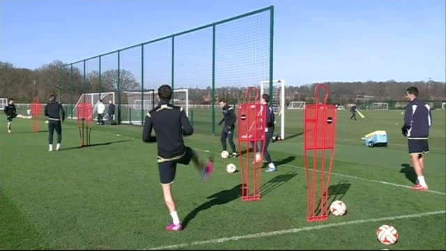 tottenham hotspur training; spurs players warming up / close shots erikssen / players dribbing ball during training / spokesman speaking to italian... - spokesman stock videos & royalty-free footage