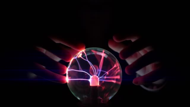 Touch on plasma ball at night