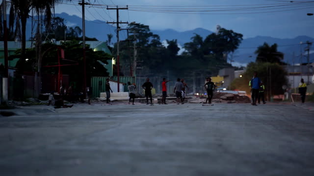 ws tilt up touch rugby in the street at dusk/ papua new guinea - papua new guinea stock videos & royalty-free footage