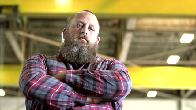 tough man with beard staring at camera - construction worker stock videos & royalty-free footage