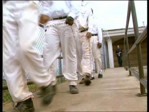 alabama huntsville lams prisoners along chained together twds bcms prisoners chained together by the ankles as they walk along track - prisoner walking stock videos & royalty-free footage