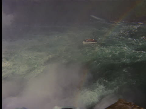 aerial tour boat below niagara falls - ausflugsboot stock-videos und b-roll-filmmaterial