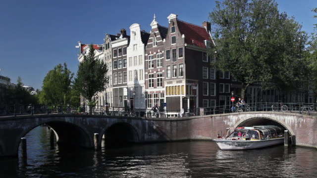 WS Tour boat crossing Keizersgracht canal / Amsterdam, Holland