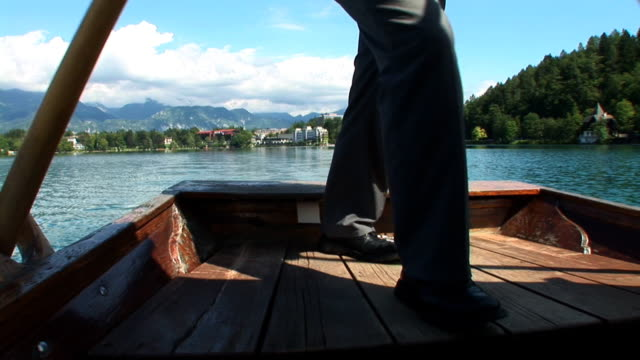 hd: tour boat of bled - lake bled stock videos & royalty-free footage