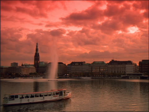 tour boat on alster lake at sunset / hamburg - 1992 stock-videos und b-roll-filmmaterial