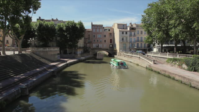 ws tour boat on canal du midi / beziers, languedoc-roussillon, france - canal du midi stock videos & royalty-free footage