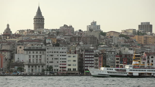 ws tour boat on golden horn with beyoglu district and galata tower in background / istanbul, turkey - circa 14th century stock videos & royalty-free footage
