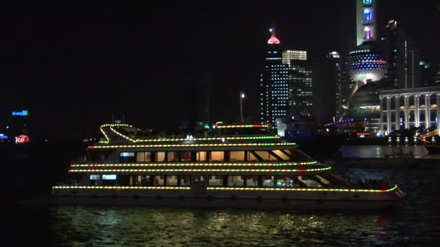 MS PAN Tour boat on Huangpu River with Pudong in background/ Shanghai, China