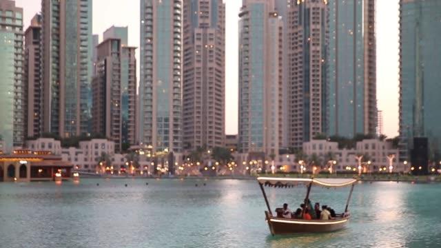 MS A tour boat travels on Burj Khalifa Lake in front of the Dubai mall and the Burj Khalifa the world's tallest building on April 9 2014 in Dubai...