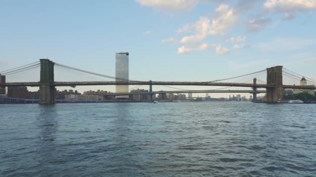 tour boat view of brooklyn bridge - new york - lower east side bildbanksvideor och videomaterial från bakom kulisserna