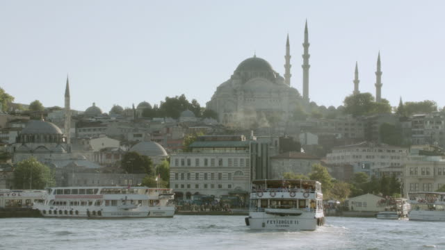 ws tour boats in the busy bosphorus strait near the suleymaniye mosque / istanbul, turkey - suleymaniye mosque stock videos and b-roll footage