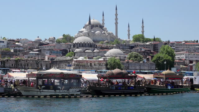 ws tour boats on golden horn with suleymaniye mosque in background / istanbul, turkey - suleymaniye mosque stock videos and b-roll footage