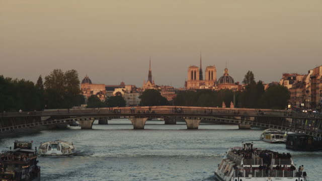ws tour boats on river seine with city skyline in background / paris, france - notre dame de paris stock videos and b-roll footage