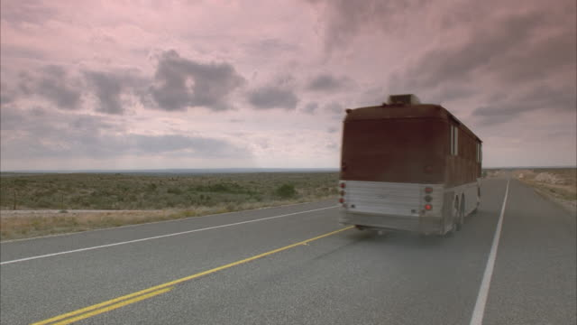 ws, tour bus and semi-track riding on highway, texas, usa - tour bus stock videos and b-roll footage