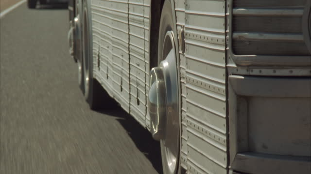 stockvideo's en b-roll-footage met cu, pan, tour bus and semi-track riding on highway, texas, usa - dubbeldekker bus