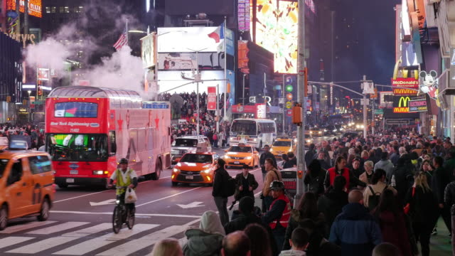 Tour bus and tourists in Times Square, New York City