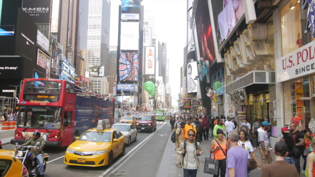 tour bus and yellow taxi in nyc manhattan times square - international landmark stock videos & royalty-free footage