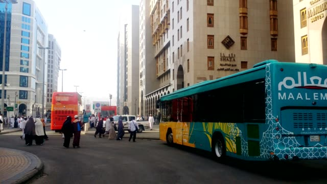 tour buses for city sights scenes for tourist and pilgrims near the prophet's mosque - pilgrimage stock videos & royalty-free footage